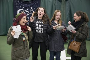 Freshman Ari Scott receives her bid alongside her floor-mates at the Indiana University Tennis Center on Tuesday. The women received their bids together and left with their respective houses on buses.