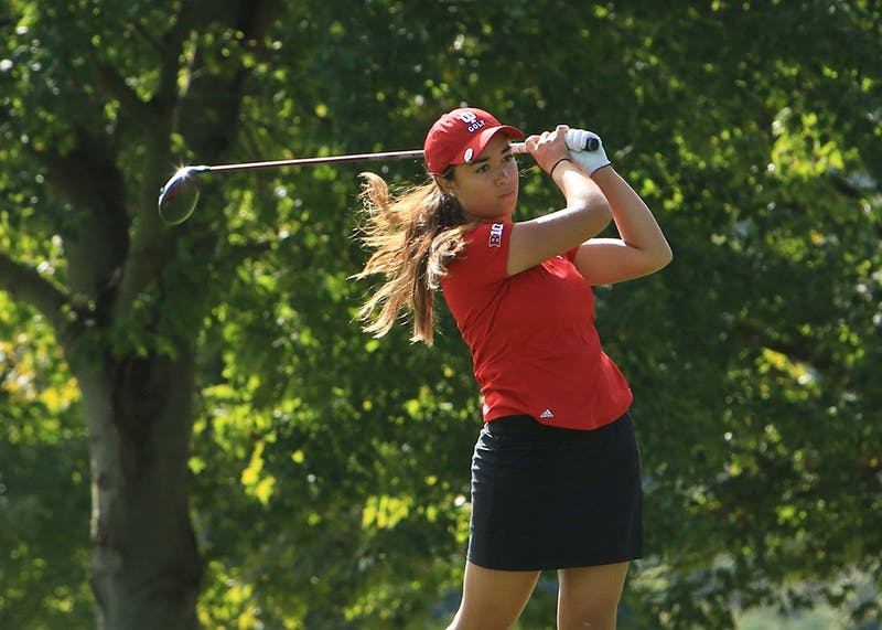 Freshman golfer Mary Parsons finishes her swing after a drive at the Bettie Lou Evans Invitational in Lexington, Kentucky. Parsons set a new IU single-round scoring record by shooting a 66 in the third round of the tournament.
