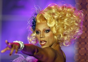 """RuPaul walks the runway in his famous drag queen guise during a taping of """"RuPaul's Drag Race"""" in 2009 in Culver City, California. """"Drag Race,"""" a show in which drag queens compete to be crowned America's Next Drag Superstar, will air """"All Stars 3"""" in January 2018."""