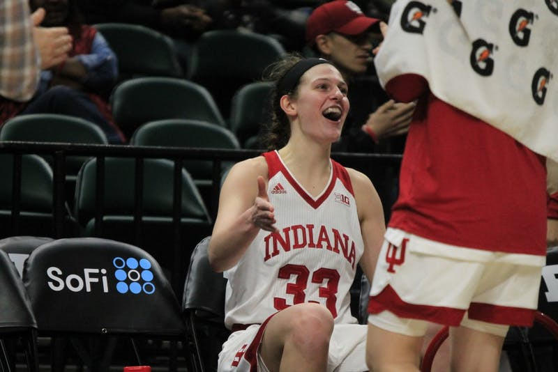 Senior forward Amanda Cahill cheers after she brings IU into triple overtime. IU faced Michigan State in a historic game Thursday, March 1, after going into quadruple overtime. Cahill recently ran a family basketball camp from June 3-5.