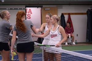 Sophomores Emma Love and Pauline Jahren shake hands with their opponents after their win of 7-5 at the IU Winter Invitational Tournament. The Hoosiers get set to play Western Michigan and Butler this Saturday to begin dual match play.