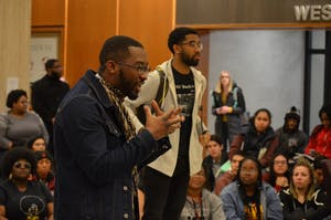 Senior Calvin Sanders tells students to take their momentum to go out and fix what they know is wrong. The Black Student Union at IU organized a sit-in Thursday at the Herman B Wells Library to discuss microaggressions, which are statements regarded as subtle discrimination.