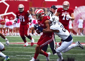Junior wide receiver Simmie Cobbs Jr. attempts to run the ball before being tackled by Charleston Southern during the Oct. 7 game at Memorial Stadium. IU lost to No. 18 Michigan State 17-9 Saturday in East Lansing, Michigan.