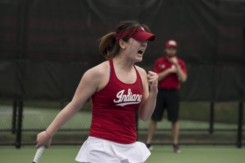 Senior Xiwei Cai celebrates after winning her singles match against Ohio State 5-7, 6-3, 11-9. Cai took the only point for the Hoosiers during their 1-6 loss to OSU. IU will play Maryland and Rutgers on the road this weekend with Big Ten Tournament implications on the line.