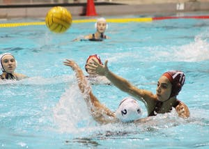 Then-IU freshman Joelle Nacouzi, now a sophomore, attempts to block a pass by Paizlee Dreyer of California Baptist University. IU water polo released its 2018 schedule last week.