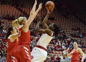 Freshman guard Bendu Yeaney scores against Western Kentucky during Friday's game at Simon Skjodt Assembly Hall. IU won, 73-71.