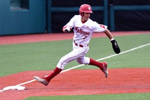 Sophomore infielder Matt Gorski rounds third base against Cincinnati on Tuesday evening at Bart Kaufman Field. IU lost its series against at Ohio State, 2-1.