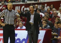 IU Coach Tom Crean disputes a call in a game against Michigan in February. Crean has signed with ESPN to be a studio analyst and in-game commentator for the upcoming college basketball season.