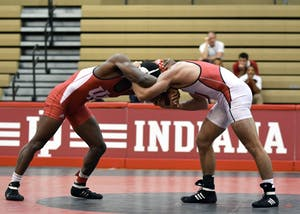Redshirt freshman Austin Holmes and redshirt freshman Davey Tunon wrestle in the 149 lb weight class in the Cream and Crimson dual on Oct. 26 at the University Gym. On Friday, the Hoosiers fell to No. 8 Michigan, 43-0.