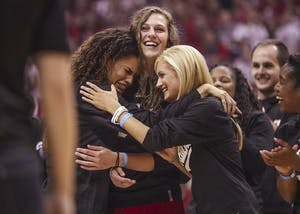 Sophomore forward Bre Wickware (left), senior forward Amanda Cahill (middle) and senior guard Tyra Buss (right) hug while Coach Teri Moren talks to the crowd during Hoosier Hysteria on Saturday. Cahill and Buss both received preseason All-Big Ten accolades Monday.