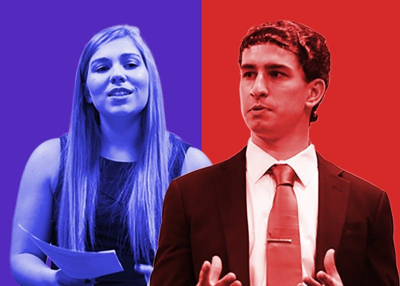 Raegan Davis, a sophomore member of the Indiana University College Democrats, and Matt Bludgen, a freshman member of the College Republicans at Indiana University, participate in a debate Monday night in the IMU. The debate covered three topics: school vouchers, minimum wage and healthcare.