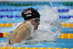 IU swimmer Lilly King swims to a gold medal in the women's 100-meter breaststroke Aug. 8, 2016, at the Olympic Aquatic Stadium in Brazil. King is one of two IU swimmers nominated for a Golden Goggle Award, an award that honors swimmers' achievements over the last year.