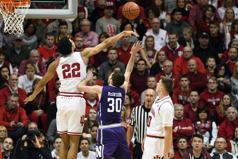 Freshman forward Clifton Moore blocks a shot against Northwestern on Sunday evening in Simon Skjodt Assembly Hall. IU defeated Northwestern, 66-46, to move to 11-7 on the season.