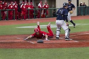 Junior outfielder Logan Kaletha slides into home to score a run for the Hoosiers. IU lost to Illinois, 5-4 on Friday.