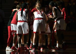 The IU women's basketball team huddles up prior to their game against Louisville on Nov. 30 in Simon Skjodt Assembly Hall. IU beat Norther Kentucky, 67-56, on Saturday night.