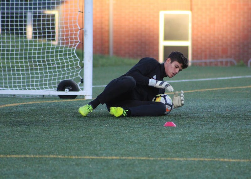 Freshman goalkeeper Trey Muse saves a shot during warm-ups before IU's match against the Butler Bulldogs Wednesday night in Indianapolis. Muse recorded another shutout in the IU goal, extending the team's shutout streak to almost 900 straight minutes, as the Hoosiers drew the Bulldogs, 0-0.