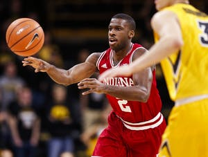 Senior guard Josh Newkirk passes the ball while driving inbound during the Hoosiers' game against the Iowa Hawkeyes on Saturday at Carver-Hawkeye Arena in Iowa City, Iowa. The Hoosiers beat the Hawkeyes, 84-82.