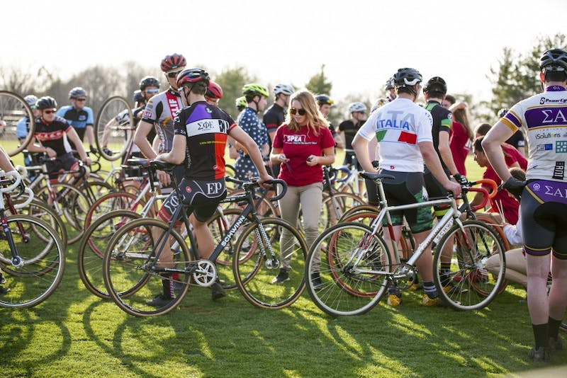 <p>IU Student Foundation members chip bikes to track and time riders during a practice session for Little 500 on Thursday evening at Bill Armstrong Stadium.</p>
