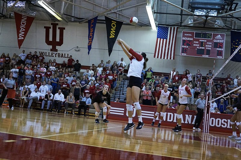 Junior right side hitter Elizabeth Asdell (14) bumps the ball over for a point against Indiana State University during the Indiana Invitational in August. The Hoosiers have two opportunities to win a Big Ten match this weekend against Rutgers and No. 1 Penn State.