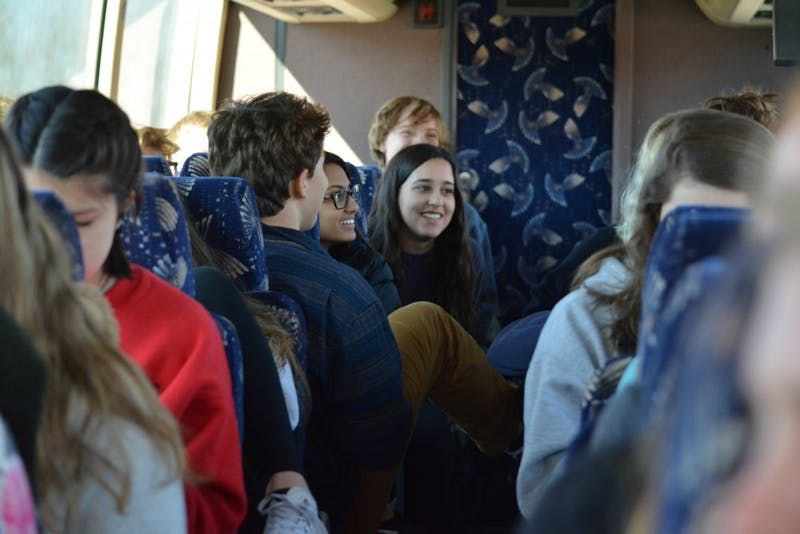 """Students from Bloomington high schools traveled Friday to the March for Our Lives rally in Washington, D.C. To stay energized on the long bus ride, they took naps, played """"Never Have I Ever"""" and talked about everything from Pokémon to politics."""