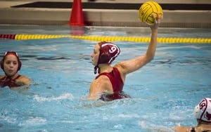 Attacker Sarah Myers throws the ball to a teammate against Marist College on Sunday. The Hoosiers won 10-3 at the Councilman Billingsley Aquatics Center.