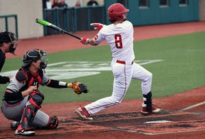 Junior infielder Luke Miller takes a swing against Cincinnati on March 6 at Bart Kaufman Field. IU will play Iowa in a three-game series this weekend to begin Big Ten Conference play.