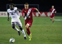 Freshman midfielder Griffin Dorsey dribbles the ball against Santa Clara Saturday night at Bill Armstrong Stadium. Dorsey had two assists and one goal in IU's 5-0 win over Santa Clara, but he will be away with the United States Under-18 National Team for the next two IU matches.