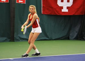 Then-sophomore Madison Appel, now a junior, serves the ball during a women's tennis doubles match against West Virginia in March 2017. Appel and the Hoosiers lost to Notre Dame Saturday, 4-3.