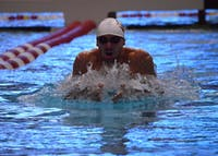 Then-sophomore Blake Pieroni, now a senior, dives off the starting block during the 100-yard breaststroke during a 2015 meet against Cincinnati at the Counsilman Billingsley Aquatic Center. Pieroni won both the 200m freestyle with a time of 1:34.10 and the 100m freestyle by touching the wall with a time of 43.18 in IU's first meet of the 2017-18 season against Florida and Texas.