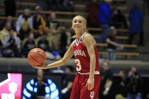 Senior guard Tyra Buss smiles watching the clock as she realizes the Hoosiers beat the Purdue Boilermakers. IU traveled to West Lafayette, Indiana to take on Purdue and won, 52-44.