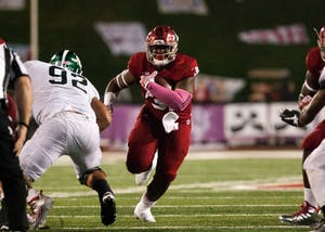 Then-freshman running back Tyler Natee, now a sophomore, runs the ball against Michigan State during an October 2016 game. Natee was one of two IU players to announce their intent to transfer to a different school this past week via Twitter.