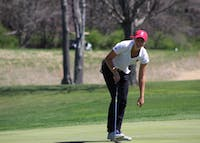 Freshman Emma Fisher picks her ball out of the hole after sinking a putt on April 8, 2017, during the IU Invitational at the IU Golf Course. Fisher and the IU women's golf team will travel to Lexington, Kentucky, this weekend for the Bettie Lou Evans Invitational.