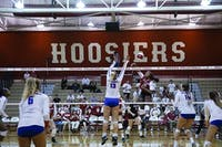 Sophomore Deyshia Lofton (16) spikes the ball for a kill leading the Hoosiers to their second win against DePaul University in August. IU women's volleyball will aim for its first conference win Wednesday night against Iowa.