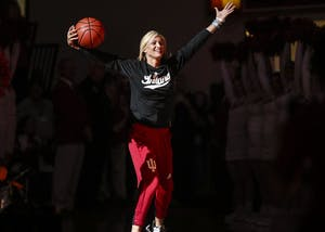 Senior guard Tyra Buss enters Branch McCracken Court during Hoosier Hysteria on Saturday. This year's Hoosier Hysteria was the last for Buss.