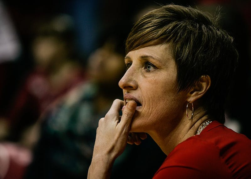 Head coach Teri Moren takes a knee at the edge of the court during the fourth quarter of play in 2016. Moren has added a 10th player to the women's basketball team in junior walk-on guard Grace Withrow.