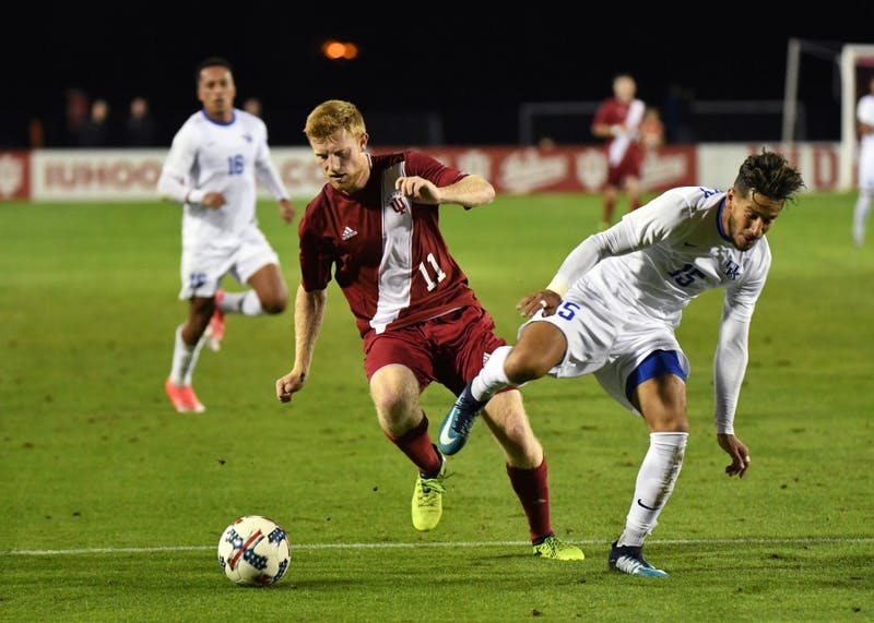 Junior midfielder Cory Thomas dribbles the ball against Kentucky Wednesday evening at Bill Armstrong Stadium. IU has only four matches remaining in the regular season.