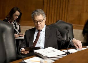 U.S. Sen. Al Franken (D-Minn.) looks over his notes prior to hearing Alex M. Azar II testify before the Senate Committee on Health, Education, Labor and Pensions on his nomination to be Secretary of Health and Human Services on Wednesday, Nov. 29 on Capitol Hill in Washington, D.C. A series of Senate Democratic women issued calls for Franken to resign that morning.