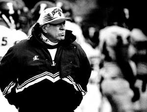 Former IU Coach Bill Mallory watches IU play the Purdue Boilermakers in West Lafayette, Ind., for the Old Oaken Bucket in 1996. Mallory was placed in hospice care on Thursday.
