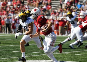 Sophomore quarterback Peyton Ramsey runs the ball against Michigan on Saturday afternoon at Memorial Stadium. Michigan defeated IU 27-20.