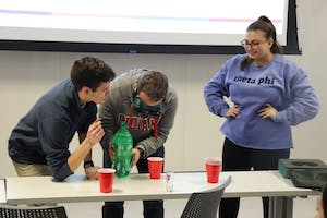 Students Tom Sweeny and Drew Ficociello lead an activity about alcohol consumption and the dangers that come along with it during the callout meeting for Culture of Care. The activity was put in place to help the audience understand what their goals are as a club.