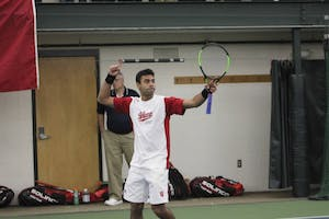 Then-junior Raheel Manji celebrates his doubles win against Princeton on Saturday, Feb. 4, 2017, in Bloomington. The IU men's tennis team lost to Texas Tech this weekend.