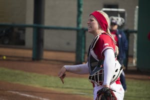 Freshman catcher Maddie Westmoreland yells to the outfield in the final inning of IU's game on March 18 against the University of Illinois at Chicago. The Hoosiers have the chance to stay on top of the Big Ten with a matchup against Penn State this weekend.