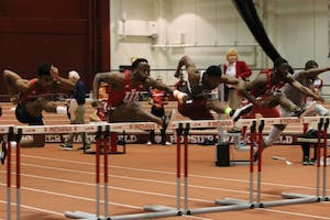 IU hurdlers William Session and Moses Baryoh jump the first hurdle in the 60-meter hurdles at the 2018 Hoosier Hills meet. Session earned first place with a time of 7.68.