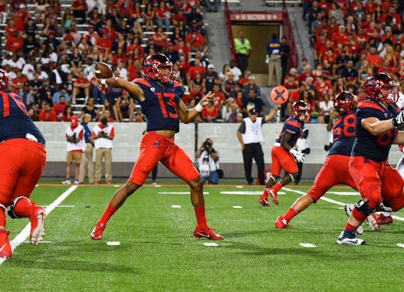 Arizona quarterback Brandon Dawkins passes the ball during the Arizona-Houston game Sept. 9, 2017, at Arizona Stadium. Dawkins is one of seven quarterbacks on the IU roster.