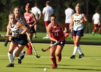 Sophomore forward Sam Scire tracks down a ball against Michigan on Friday afternoon at the IU Field Hockey Complex. IU lost to No. 3 Michigan, 2-0, and to Michigan State, 3-2, this past weekend.