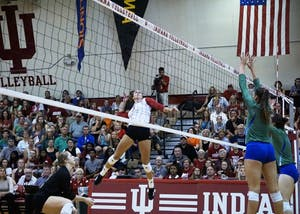 Senior outside hitter Jessica Leish jumps up for a kill while sophomore defensive specialist Meaghan Koors stays by for support. Leish is the only senior on this year's IU volleyball roster, and will be one of two players honored by the Hoosiers during Senior Night later this week.