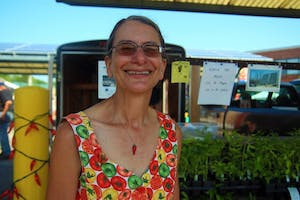 Susan Welsand stands in her booth where she sells chili plants. She is the owner of The Chile Woman, and her main source of business is through shipping chili plants all around the country.
