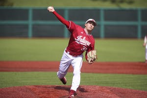 Junior pitcher Jonathan Stiever pitches the ball against the Butler Bulldogs on March 30 at Bart Kaufman Field. Stiever and IU lost to Illinois, 7-1, on Wednesday night in the Big Ten Tournament.