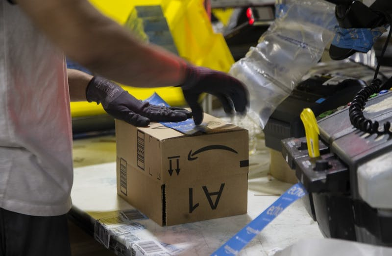 A worker tapes a box while packing items on Cyber Monday at the Amazon Fulfillment Center in San Bernardino, California. Indianapolis is a finalist among 19 other cities for Amazon's second headquarters in North America, known as Amazon HQ2.