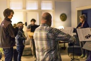 Professor Steve Wagschal plays violin with the rest of La Perla del Medio Oeste. The group had rehearsals in La Casa Latino Cultural Center in preparation for performances.